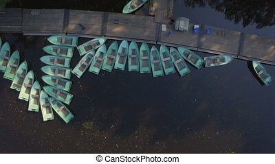 aerial view of Marina with lots of tethered row boats. They...