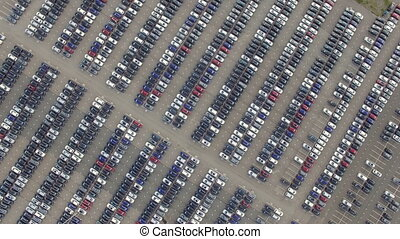 Flying Above Storage Parking Lot of New Unsold Cars, aerial view