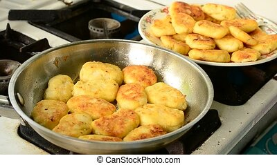 Cottage cheese pancakes fried in a frying pan on gas stove...