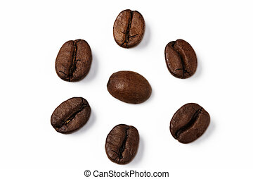 closeup of one coffee bean surrounded by other coffee beans