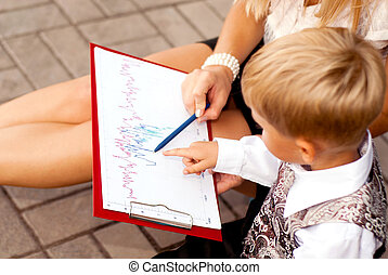 Baby blond businessman - Baby businessman studying drawings...