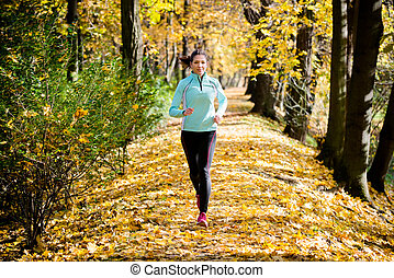 Woman jogging in nature - Young woman running and training...