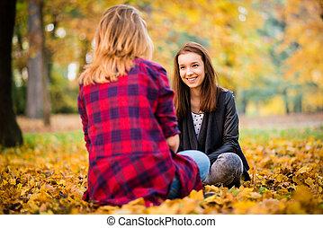 Friends talking outdoor - Two friends - teenage girls...