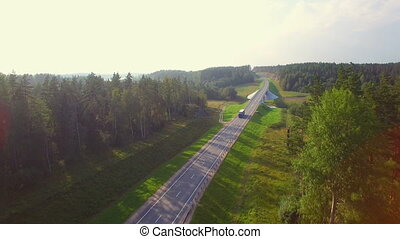 Beautiful aerial view of the truck coming down the road in...