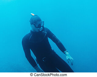 Underwater image of diver - Underwater image of young man in...