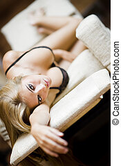 lingerie sexy girl - sexy young blond girl laying on a sofa...