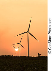 silhouette of wind turbines at sunset - silhouette of wind...