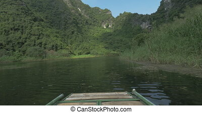 Riding in cave from first-person on boat on the river with...