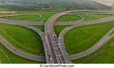 Aerial view of Highway Junction On the road going trucks and...
