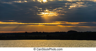 Sunset in clouds - Decline in clouds of the sun with beams...