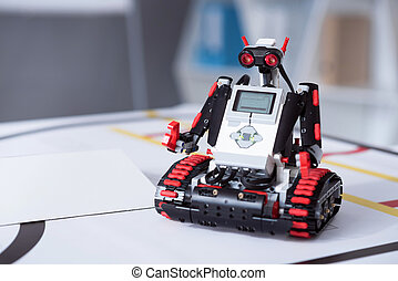 Small hunan-like robot sited on the table - Brand-new life....