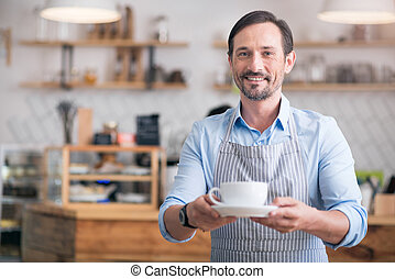 Handsome man holding hot drink