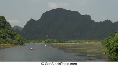 Boat tours in Trang An, Vietnam - Touristic boat sailing...