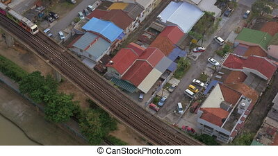 Bird eye view of poor district and riding train on railways...