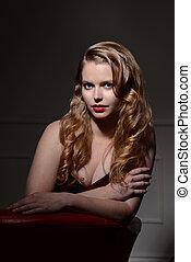 brunette woman posing on chair - portrait of brunette woman...
