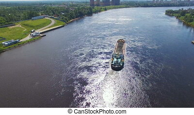 aerial view of cargo barges with crushed stone