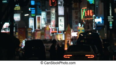 Night street with illuminated banners in Seoul, South Korea...