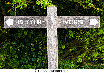 BETTER versus WORSE directional signs - Wooden signpost with...