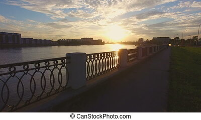 beautiful sunset on a waterfront of the Neva river