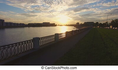 aerial view of the embankment of the river Neva at sunset