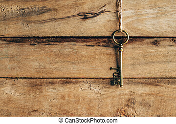 old key hanging on brown wood and Love concept