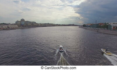 aerial view of two boats sailing on the river Neva. One...