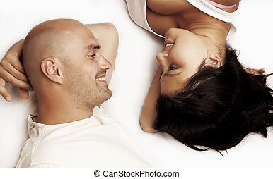 Young happy couple - Vertical image of a couple lying head...
