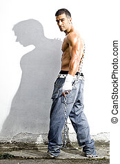 sexy rude man in a grunge background