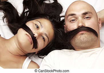 Young happy couple - Couple lying head to head and makes a...