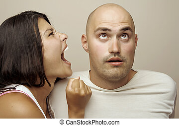 Young couple fighting.Studio shot - Young couple - man and...
