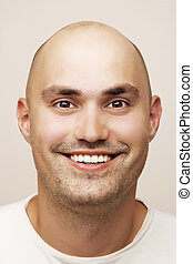 Man in white t-shirt - Head shot of bald man in white...