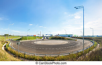 Empty roundabout in suburb - Panoramic view of an empty...