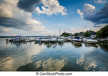 Boats docked on the Potomac River waterfront, in Alexandria,...