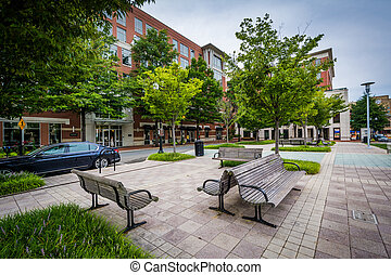 Benches and buildings at John Carlyle Square, in Alexandria,...