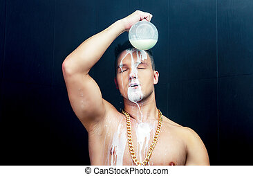 man pouring milk to his head out of the jar