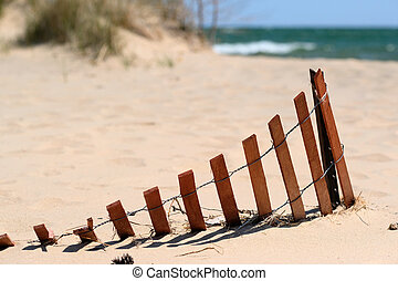 Beach at Lake Huron - Beach with wooden fence at Lake Huron,...