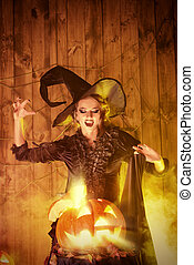 hat black - Enchanting witch and pumpkin with shining eyes...