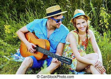 love confession - Enamored young man with a guitar singing...