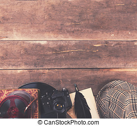 background of vintage media equipment on wooden table