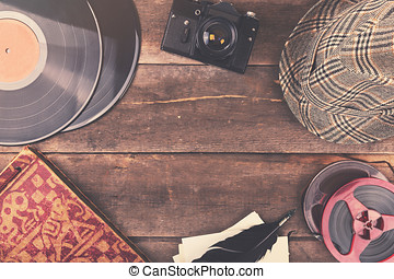retro accessories on wooden table with copy space