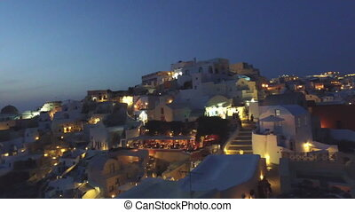 Sunset in Oia Santorini - SANTORINI, GREECE White buildings...