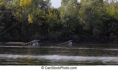 a Wakeboarder Jumps on the Wakeboard Over the Springboard....