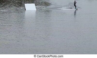 Rider wakeboard performs amplitude trick. Breathtaking...