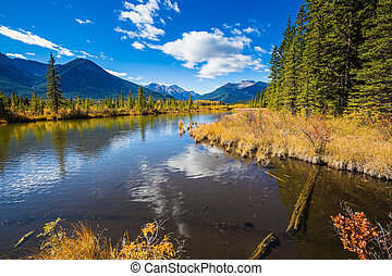 Shallow Lake Vermilion is surrounded by mountains and...