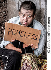 Prayerful eyes of homeless woman - Homeless young woman...