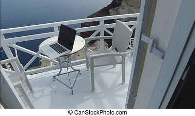 Working outdoor on terrace - laptop and relaxing in your...