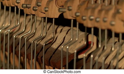 View of moving piano hammers, close-up