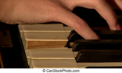 Close-up of musician's hands playing piano - View of...