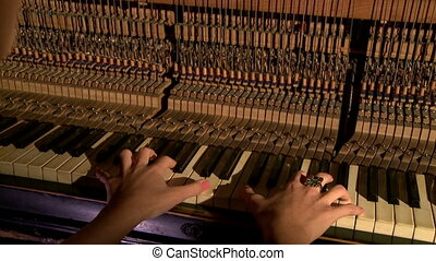 Hands of pianist. Piano inside - hammers and keys - Hands of...