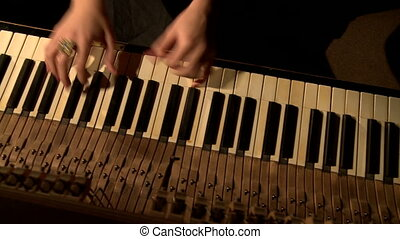 Woman with groomed hands playing piano Top view - Young...
